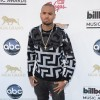 Chris Brown kept his look casual in a grey crewneck and faded black jeans #BillboardMusicAwards