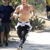 Colin Farrell catches a tan while jogging shirtless in Hollywood