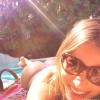 Sofia Vergara smiles while tanning poolside in a tiny thong