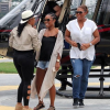Spotted: Queen Latifah and wifey Eboni Nichols arriving in the center of Rio de Janeiro  by helicopter
